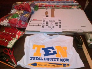 TEN T-shirt With Holiday Book Drive Box Materials